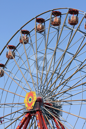 Ferris wheel stock photo, Big ferris wheel at amusement park and blue sky by EVANGELOS THOMAIDIS