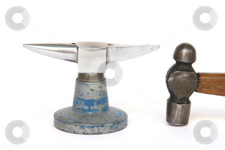 Small anvil stock photo, Small anvil and hammer from jewelry manufacture isolated by EVANGELOS THOMAIDIS