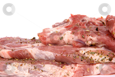 Copyspace pork chops stock photo, Raw pork chops with oregano  isolated  with  copy space by EVANGELOS THOMAIDIS