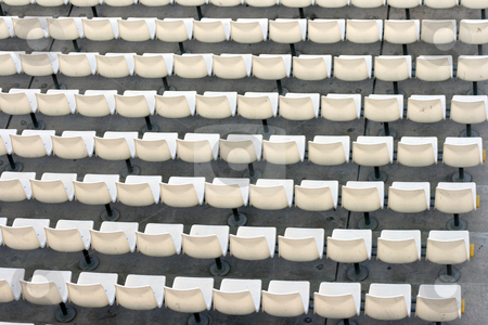 White seats stock photo, White seats texture detail from stadium for background use by EVANGELOS THOMAIDIS