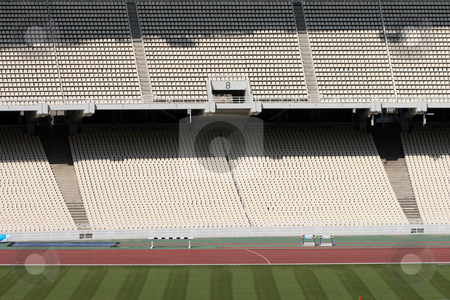 Empty stadium stock photo, Detail from athens olympic stadium filed and tiers by EVANGELOS THOMAIDIS