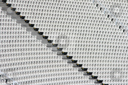 Seats tiers stock photo, White seats tiers texture detail from stadium for background use by EVANGELOS THOMAIDIS