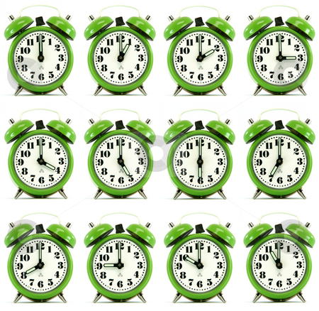 Twelve hours alarm clock stock photo, Classic small alarm clock twelve hours isolated on white background multiple image by EVANGELOS THOMAIDIS