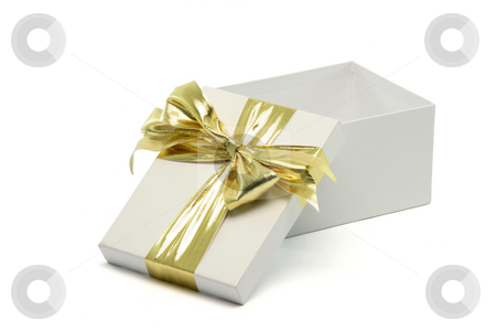 Open gift stock photo, Open white gift box with golden ribbon isolated on white background with clipping path by EVANGELOS THOMAIDIS