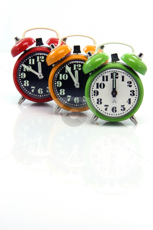 Alarm clocks small reflect stock photo, Timing red yellow and green alarm clock untill twelve oclock closeup with nice small reflection vertical by EVANGELOS THOMAIDIS