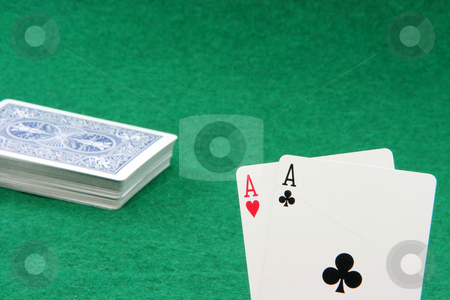 Aces stock photo, Black jack with two aces closeup and stack of cards and green felt background by EVANGELOS THOMAIDIS