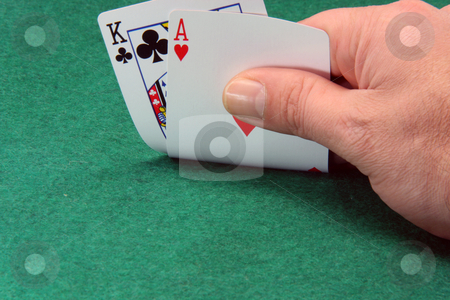 Holding ace and king stock photo, Hand holding ace and king closeup on green felt background by EVANGELOS THOMAIDIS