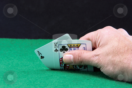 Ace and king copyspace stock photo, Hand holding ace and king closeup on green felt background and black copyspace by EVANGELOS THOMAIDIS