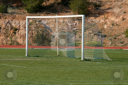 Soccer goalpost stock photo, Soccer goalpost in local football stadium sports concepts by EVANGELOS THOMAIDIS