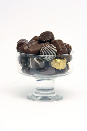 Chocolates stock photo, Chocolates in crystal bowl on white background food concepts by EVANGELOS THOMAIDIS