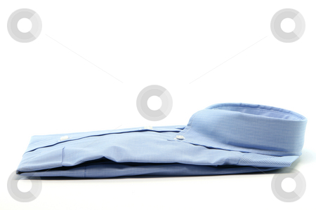 Blue shirt stock photo, Blue shirt isolated on white background with copy space fashion and clothing concepts by EVANGELOS THOMAIDIS