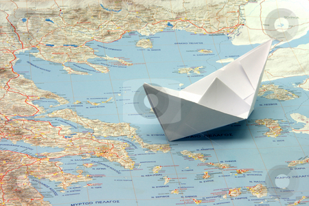 Travel to greece by boat stock photo, Travel to greek islands by boat boat figure on a map of greece by EVANGELOS THOMAIDIS