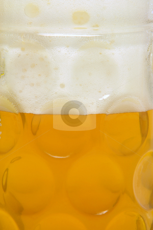 Beer and foam stock photo, Beer and foam in classic bavarian mug for background use by EVANGELOS THOMAIDIS