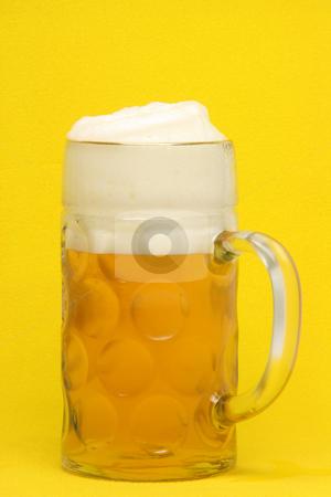 Bavarian beer mug stock photo, Classic bavarian beer mug  in yellow background by EVANGELOS THOMAIDIS