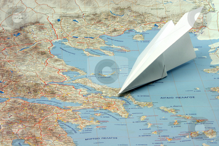 Travel to greece by plane stock photo, Travel to greek islands by airplane figure on a map of greece by EVANGELOS THOMAIDIS