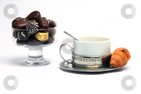 Teacup croisant chocolates stock photo, Chocolate teacup and croisant isolated on white background by EVANGELOS THOMAIDIS