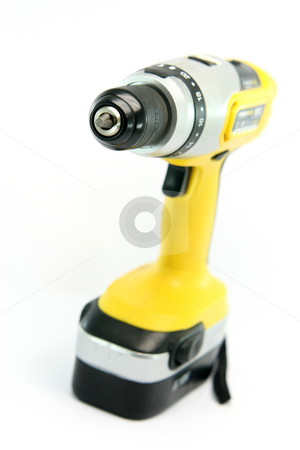Hand drill stock photo, Yellow rechargeable drill isolated on white background industrial tools by EVANGELOS THOMAIDIS