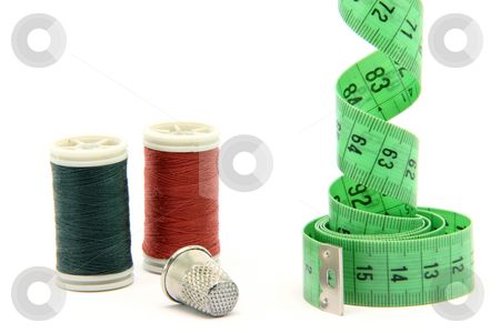 Sewing items horizontal stock photo, Sewing items measure tape cotton strings and thimble isolated on white background by EVANGELOS THOMAIDIS