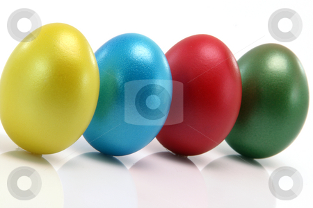 Four color eggs stock photo, Four color easter eggs with reflection isolated on white background by EVANGELOS THOMAIDIS