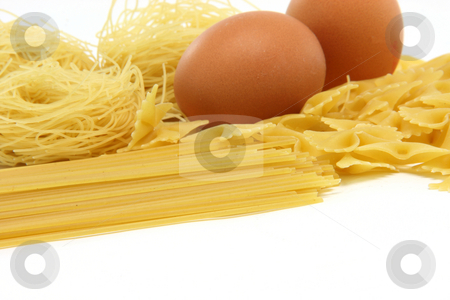 Macaroni assortmet and eggs stock photo, Spaghetti assortment and eggs isolated on white background with copy space food concepts by EVANGELOS THOMAIDIS