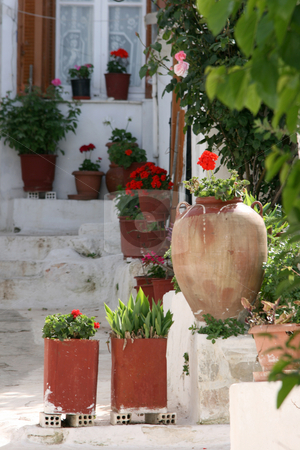 Greek house in spring stock photo, Traditional white old style greek house with flowerpots  in spring by EVANGELOS THOMAIDIS