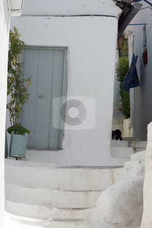 Traditional greek houses stock photo, Traditional white old style greek houses with flowerpots in spring by EVANGELOS THOMAIDIS