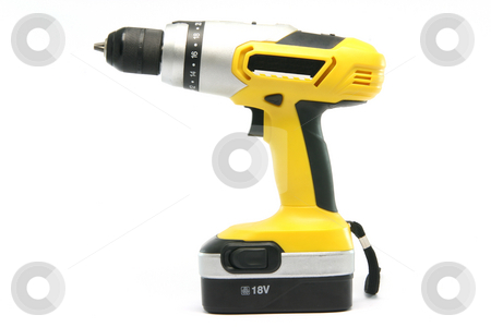 Yellow drill stock photo, Yellow rechargeable drill isolated on white background industrial tools by EVANGELOS THOMAIDIS