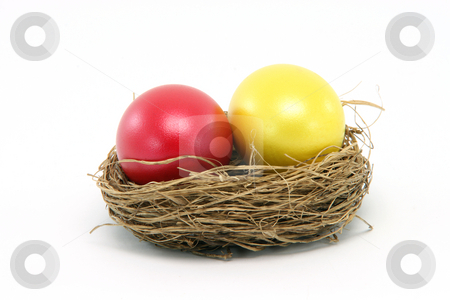 Red yellow egg stock photo, Red and yellow easter egg in a nest isolated on white background seasonal by EVANGELOS THOMAIDIS
