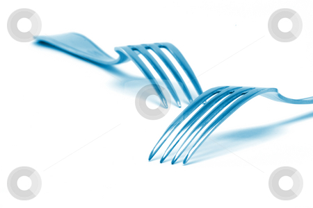 Forks stock photo, Two blue color forks isolated on white background food industry concepts by EVANGELOS THOMAIDIS