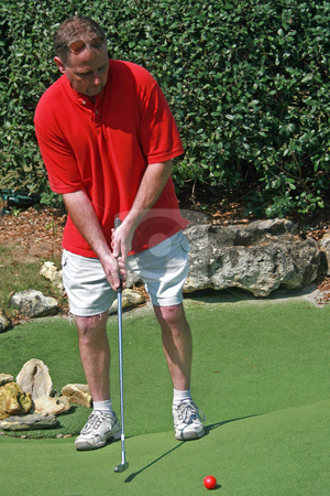 Ready to Play stock photo, Playing Adventure Golf, ball, club and man. by Lucy Clark