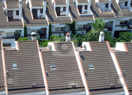 Rooftops of Spanish houses stock photo, Rooftops of Spanish houses, Calella, Spain. by Martin Crowdy