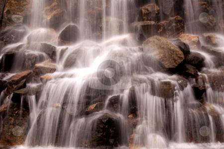Details of beautiful waterfall stock photo, Details of beautiful waterfall crashing on rocks. by Martin Crowdy