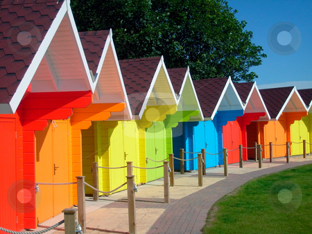 Colorful seaside beach chalets stock photo, Exteriors of beautiful bright seaside beach chalets, Scarborough, England. by Martin Crowdy