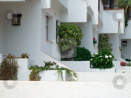 Traditional Spanish houses stock photo, Row of traditional white Spanish houses, Barcelona, Spain. by Martin Crowdy