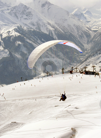 Parasailing in winter stock photo, Parasailing in Swiss Alps in the winter snow. by Martin Crowdy