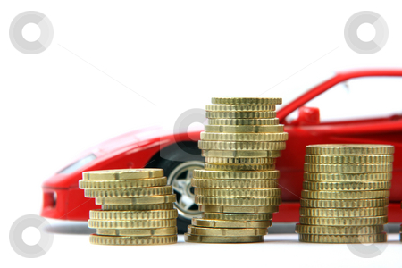Coins and red car stock photo, Coins and sports red car blur in background isolated business and finance by EVANGELOS THOMAIDIS