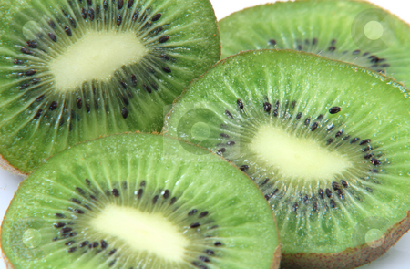 Kiwi texture stock photo, Slices of kiwi closeup for background healthy eating and agriculture concepts by EVANGELOS THOMAIDIS