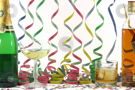 Alchohol and celebration stock photo, Alchohol whiskey champagne streamers confetti celebration and holidays concepts horizontal by EVANGELOS THOMAIDIS