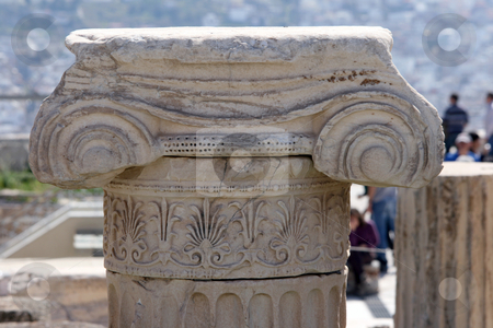 Detail from ancient pillar stock photo, Closeup detail from ancien pillar in the archaeological site of parthenon athens greece with blur tourists and city in background by EVANGELOS THOMAIDIS
