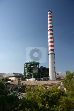 Power plant stock photo, Steam electric power plant with high red and white chimney at piraeus athens greece by EVANGELOS THOMAIDIS