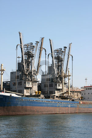 Old cargo ship stock photo, Old cargo ship at dock ready for loading by EVANGELOS THOMAIDIS