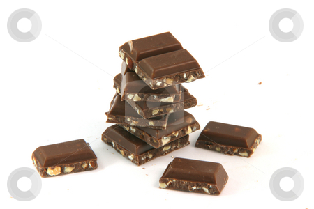 Pile of chocolate pieces stock photo, Pile of chocolate pieces closeup with copy space isolated on white background food and sweets concepts by EVANGELOS THOMAIDIS