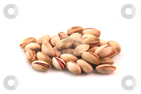 Isolated pistachios stock photo, Dry pistachios isolated on white background food concepts by EVANGELOS THOMAIDIS