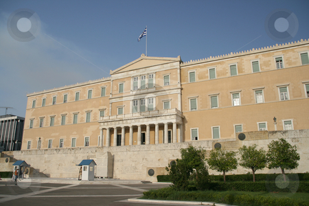 Perspective greek parliament stock photo, Perspective view of greek parliament exterior horizontal shut with tourists and guards landmakrs of athens greece by EVANGELOS THOMAIDIS