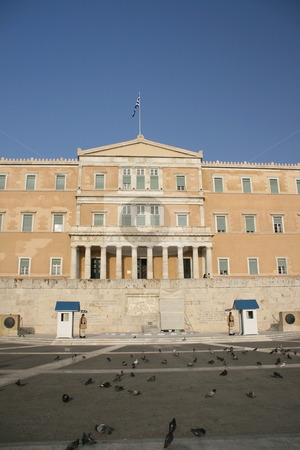Vertical parliament shut stock photo, Vertical view of greek parliament exterior with pigeons and guards landmakrs of athens greece by EVANGELOS THOMAIDIS