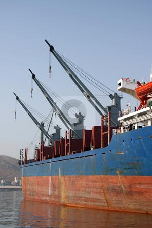 Three cargo ship cranes stock photo, Three cargo ship cranes in a row cargo and shipping industry by EVANGELOS THOMAIDIS