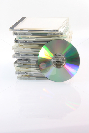 Compact disc and cases stock photo, Copact disc and pile of cd cases isolated on white background and empty label to add your message by EVANGELOS THOMAIDIS
