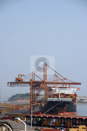 Ship unloading stock photo, Unloading container cargo ship at commercial port of piraeus athens greece by EVANGELOS THOMAIDIS