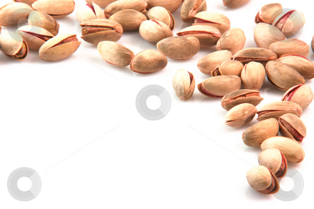 Border of pistachios stock photo, Pistachios border top view with copy space isolated on white background food concepts by EVANGELOS THOMAIDIS
