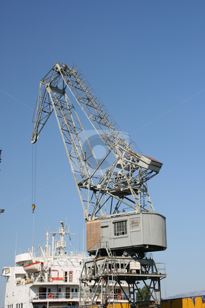 Old cargo crane stock photo, Old cargo crane above ship loading at piraeus athens greece by EVANGELOS THOMAIDIS